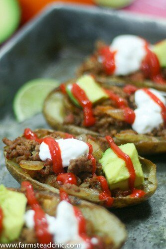 These Whole30 Beefy Taco Potato Skins are crispy and buttery, filled with savory taco meat, tomatoes + onions with an endless array of toppings. Dairy-free!