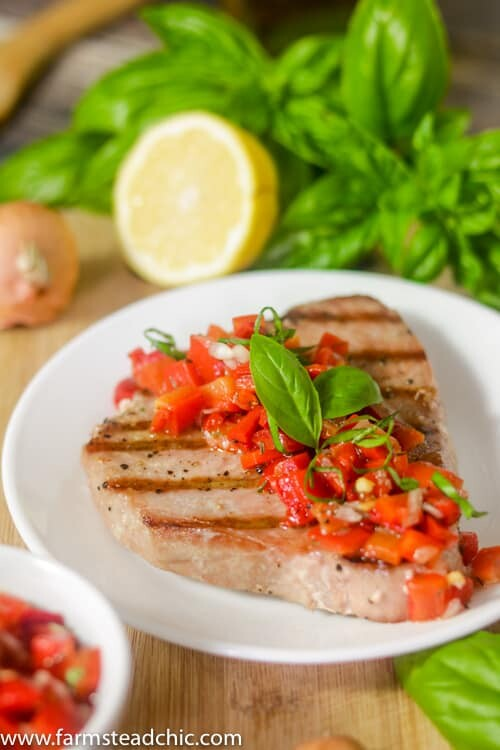 This Paleo and Whole30 Grilled Ahi Tuna with Roasted Red Pepper Relish is super simple to make but bursting with flavor.  With ingredients like jarred roasted red peppers, lemon juice, thyme and fresh basil, it's the perfect healthy (20 minute) grilled summer dinner!