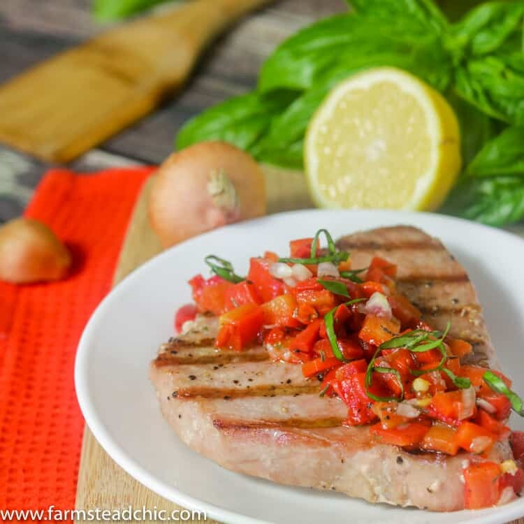 This Paleo and Whole30 Grilled Ahi Tuna with Roasted Red Pepper Relish is super simple to make but bursting with flavor. With ingredients like jarred roasted red peppers, lemonjuice, thyme and fresh basil, it's the perfecthealthy (20 minute) grilled summer dinner!