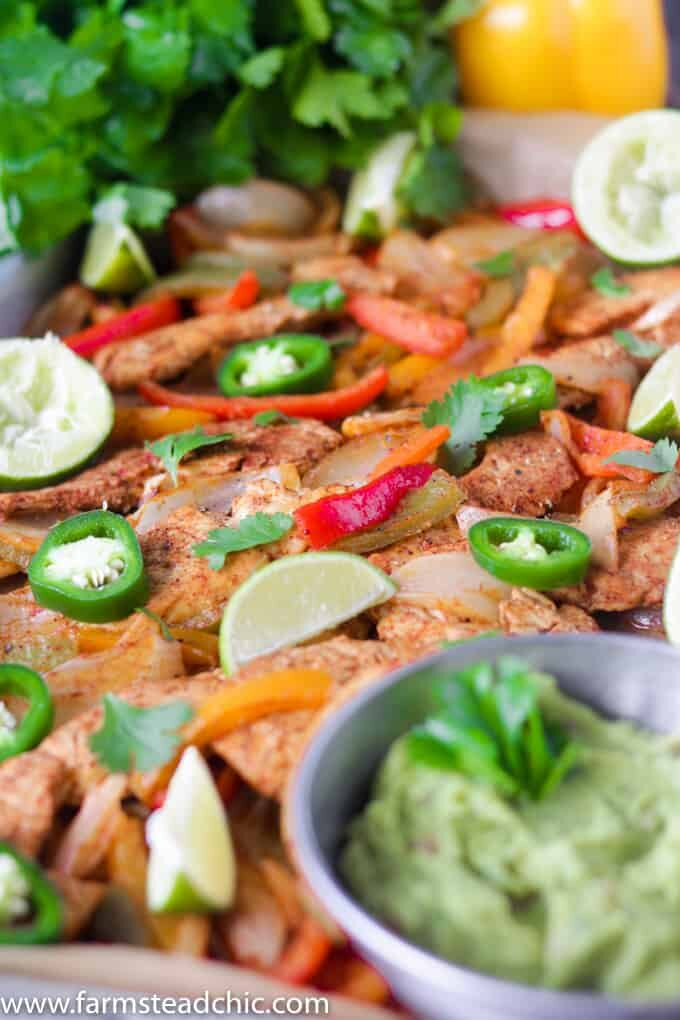 ThisPaleo and Whole30 Chicken Fajitas Sheet Pan Dinner is simple and easy with minimal cleanup! Serve it with some lime wedges, cilantro and guacamole.