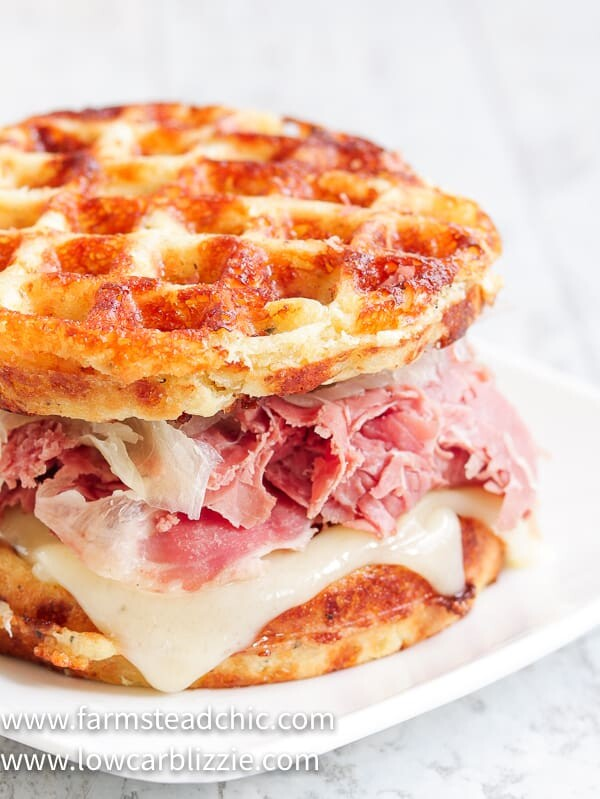 The perfect Chaffle bread, shaved corn beef,juicysauerkraut, crunchy dill pickles, melty Swiss cheese and Thousand Island dressing make this Keto Reuben Chaffle taste better than the real thing without all the harmful additives and questionable ingredients. #ketoreuben #reubenchaffle #lowcarbreuben #lowcarbsandwich #chaffle #farmsteadchic