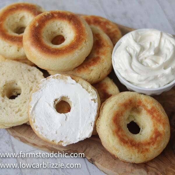 These Low Carb, Keto Bagels are based on the Fathead dough recipe and use mozzarella cheese, cream cheese, almond flour and eggs to make a dough that's surprisingly light and cream-cheese-spreadable. Add some smoked salmon, capers and sliced red onion for a Bagel and Lox. #farmsteadchic #lowcarbbagel #ketobagel #bagelandlox #smokedsalmonbagel #fatheadbagel #lowcarbbreakfast #ketobreakfast