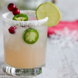 This Low Carb, Keto Spicy Cranberry Margarita is the perfect guilt-free holiday cocktail! Fresh cranberries and jalapeños add a special twist to the traditional margarita. Orange extract and a little water replace the traditional sugar-laden orange liqueur. | www.farmsteadchic.com #ketococktail #lowcarbcocktail #ketomargarita #lowcarbmargarita #spicymargarita #holidaymargarita #Christmascocktail