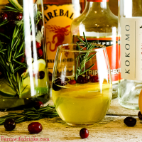 This Fireball Sangria recipe is a crisp white wine sangria with a strong cinnamon flavor. Subtle hints of orange, cranberry, and apple make this the perfect Christmas Sangria.