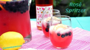 Rosé Spritzer is the sweet combination of rosé wine with tangy lemonade and ginger ale combined with blueberries and lemon slices for a refreshing summer lemonade rosé sangria.