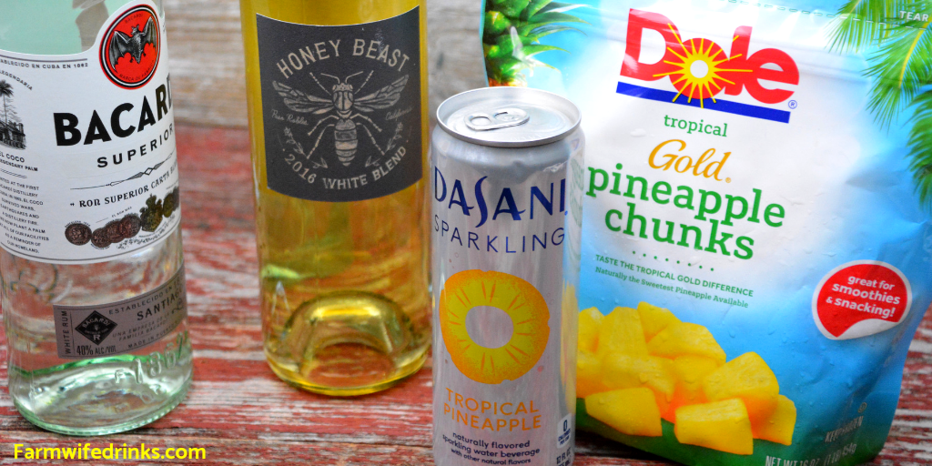 Pineapple Rum Sangria is a crisp white wine sangria combining a dry white wine, rum, frozen pineapple, and sparkling water to make a pitcher of Pineapple Sangria. #Sangria #Rum #Pineapple #Cocktails