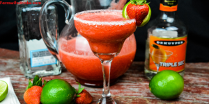 Strawberry Limeade Margaritas combine frozen limeade with fresh strawberries along with tequila and triple sec to make a whole pitcher of margaritas to enjoy. #margaritas #Strawberries #Cocktails