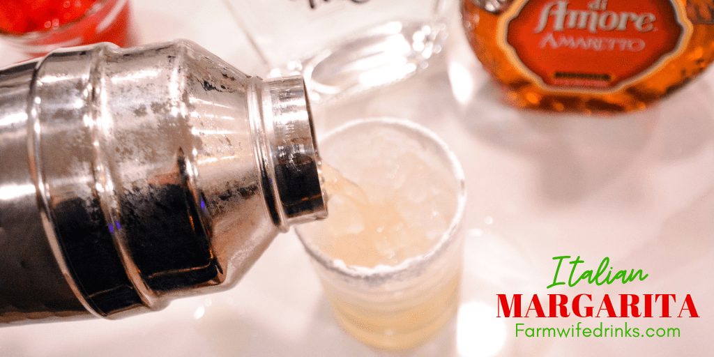 This Italian Margarita is a simple cocktail recipe made with tequila, amaretto, triple sec, and sour mix, poured into a powdered sugar rimmed glass.