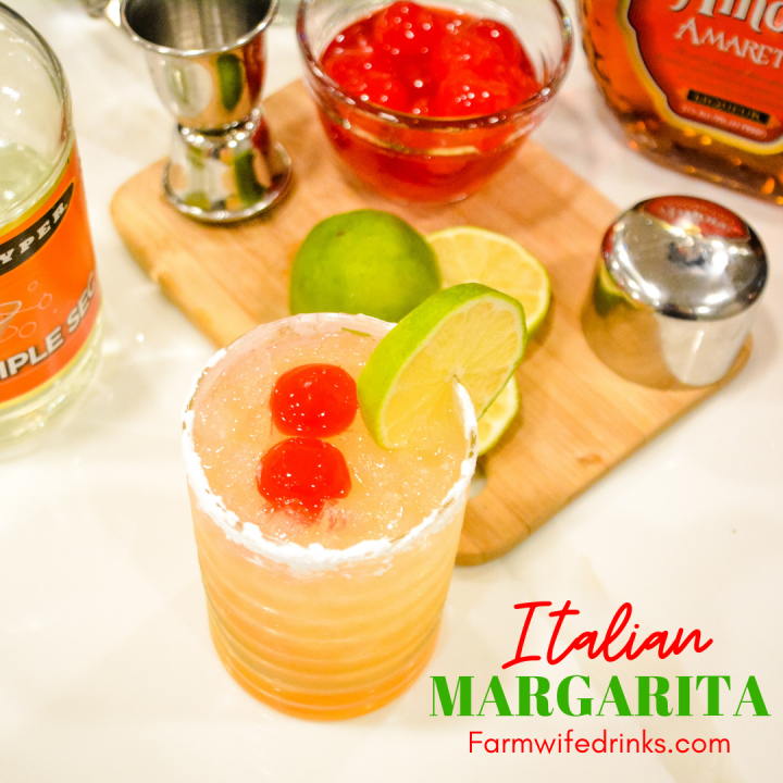 This Italian Margarita is a simple cocktail recipe made with tequila, amaretto, triple sec, and sour mix, poured into a powdered sugar-rimmed glass.