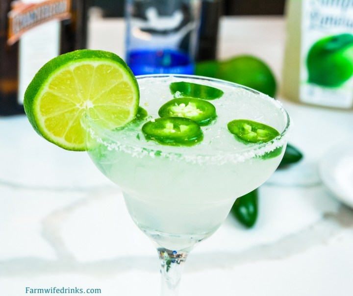 This spicy margarita does just that by combining a limeade, tequila, Cointreau with a bit of jalapeno for fresh jalapeno margaritas.