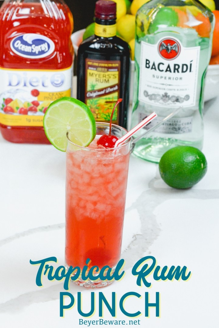 Tropical Rum Punch, by the glass or by the bowl, is delicious pineapple and cranberry juices combined with light and dark rum for a festive dark pink colored drink.