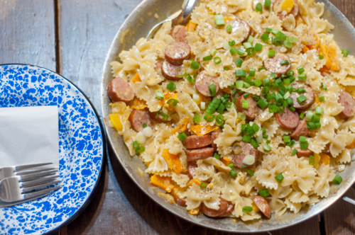 Cheesy Smoked Sausage Bowties-pasta, cheese, bell peppers, smoked sausage - a one skillet meal to feed the family!