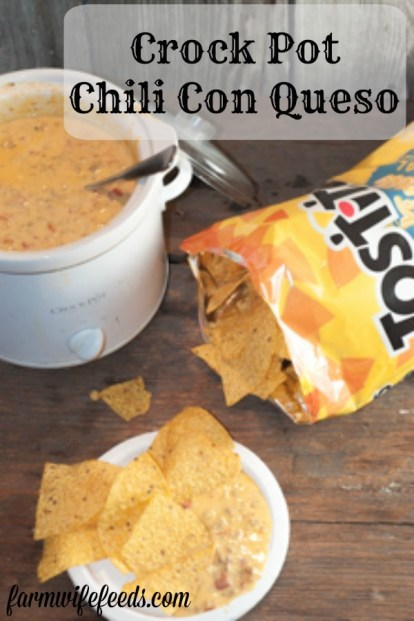 Crock Pot Chili Con Queso from Farmwife Feeds is a super easy crowd pleasing dip. #sausage #dip #crockpot #recipe