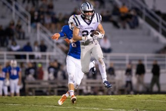 Braden Collins catches a pass over the middle against Campbell County on 9/29. PHOTO CREDIT: Carlos Reveiz, CRFOTO.com