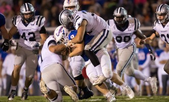 A fleet of Admirals tackle the Campbell County running back for a loss on 9/29. PHOTO CREDIT: Carlos Reveiz, CRFOTO.com