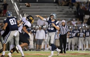 Adam Fulton throws a deep pass against McMinn on 11/4. PHOTO CREDIT: Carlos Reveiz, CRFOTO.com