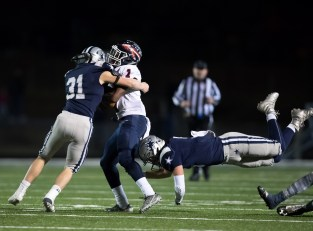Cade Burkey with a big tackle against South Doyle on 11/25. PHOTO CREDIT: Carlos Reveiz/Ashley Wathen, CRFOTO.com