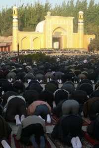 Uygur men pray at the Id Kah Mosque in Kashgar