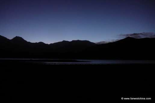 The sun rising over Karakul Lake in Xinjiang, China