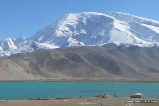 The Muztag Ata presides over Karakul Lake in Xinjiang