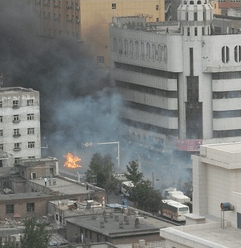 Smoke rises over Urumqi during the 2009 Uyghur riots