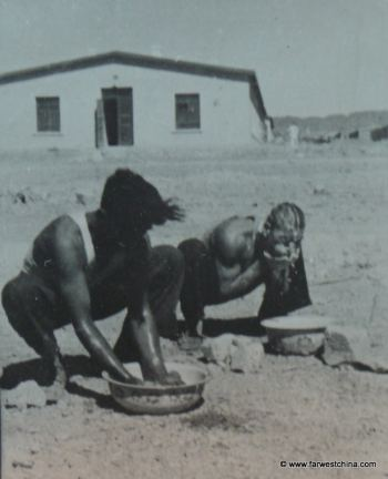 Men bathing with rationed water in China's desert