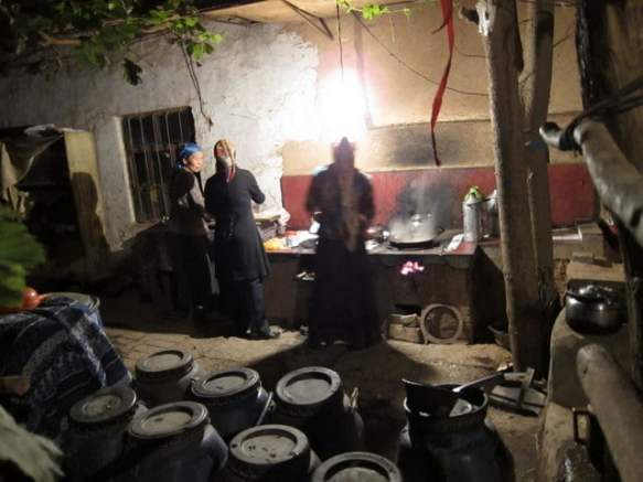 A Uyghur homestay makes dinner in Xinjiang, China