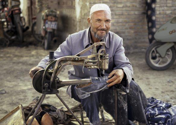 A Xinjiang shoe repair man on the streets of Urumqi