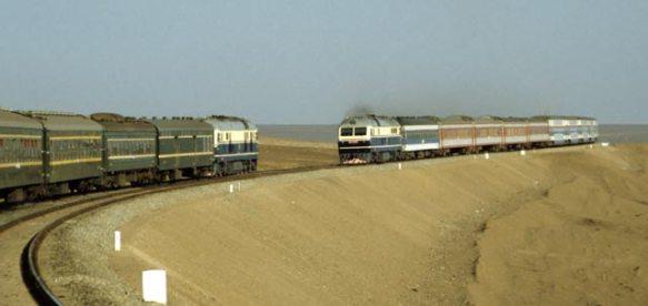 A train traveling along the Xinjiang desert