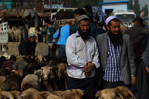 Two sheep sellers in Kashgar's Livestock Market