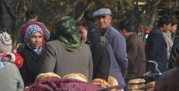 Uyghur people browsing the shops at the Muslim Friday Market