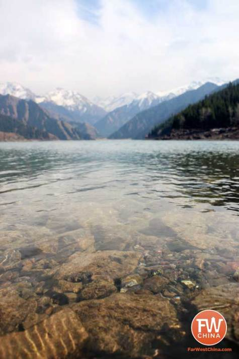 A closeup view of the crystal-clear water at Xinjiang's Heavenly Lake
