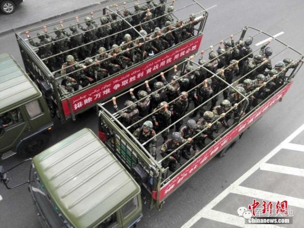Trucks full of troops fill the streets of Urumqi, Xinjiang on May 24, 2014
