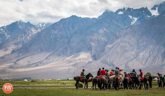 Buzkashi being played with mountains in the background