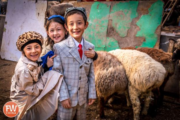 Some cute Uyghur kids dressed up for Corban Festival in Urumqi, Xinjiang