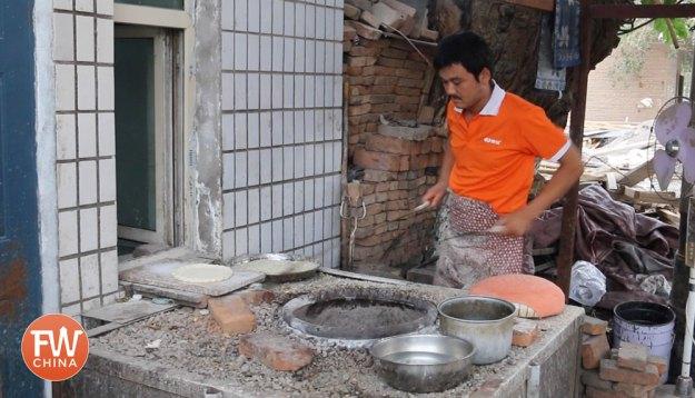 Uyghur bread maker in Xinjiang