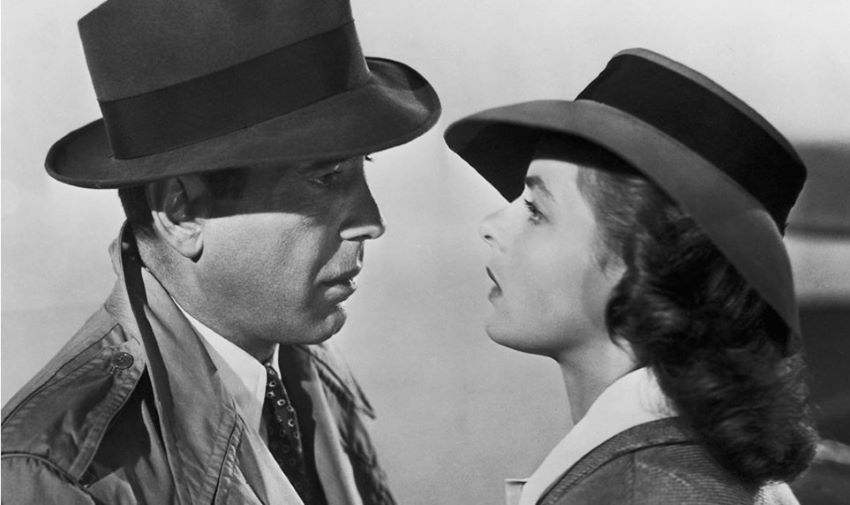 Humphrey Bogart e Ingrid Bergman com chapéu Borsalino