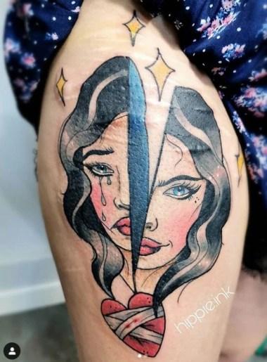 Tattoo mulher chorando com coração partido