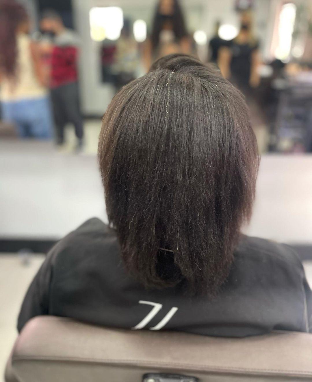 Partes de trás do cabelo natural de Lumena.