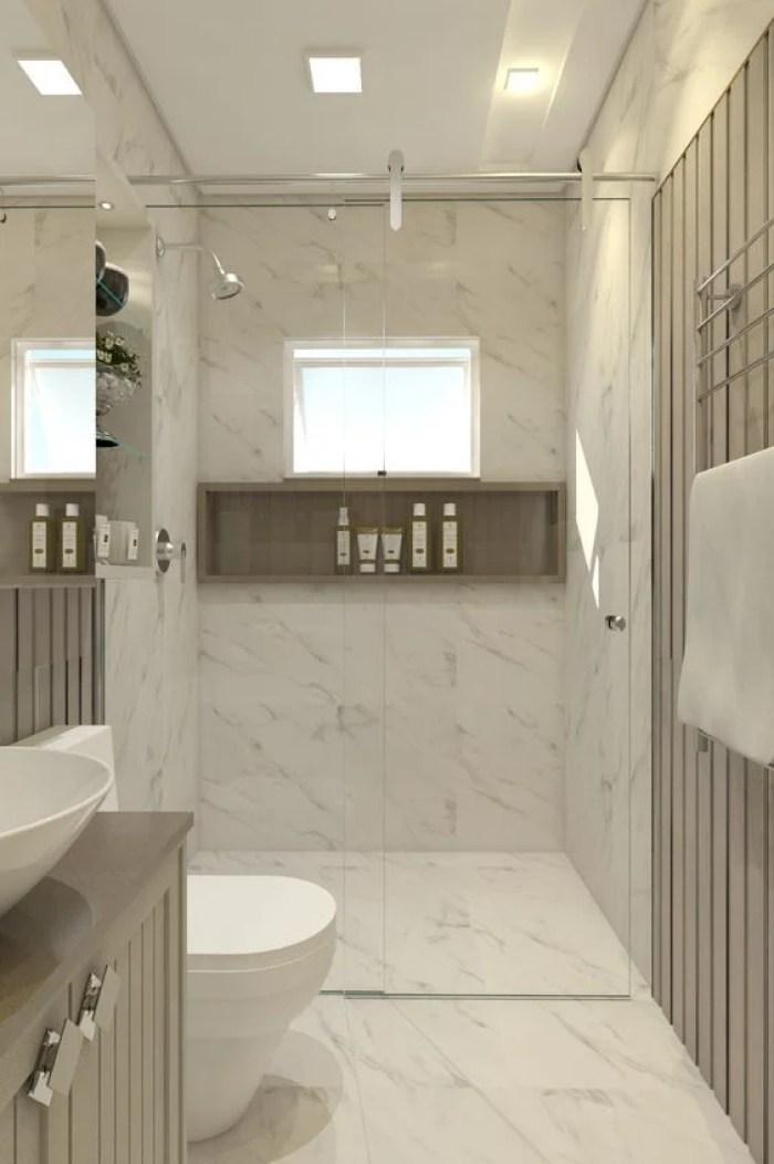 Banheiro simples revestido.