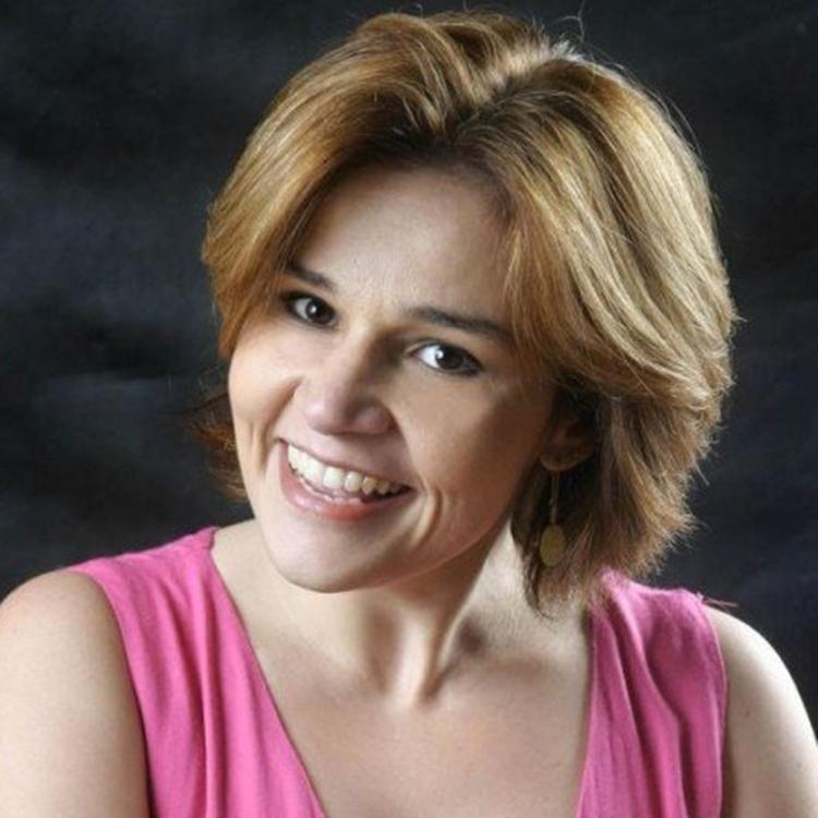 Foto da atriz Claudia Rodrigues.