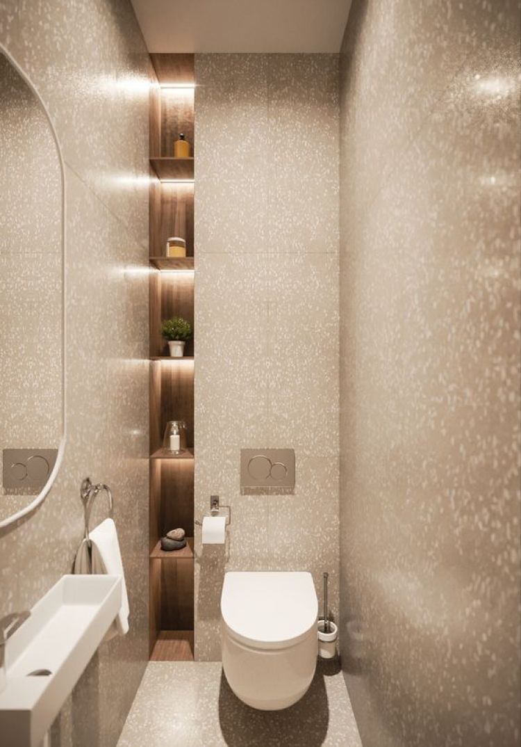 Lavabo pequeno com nichos embutidos na parede.