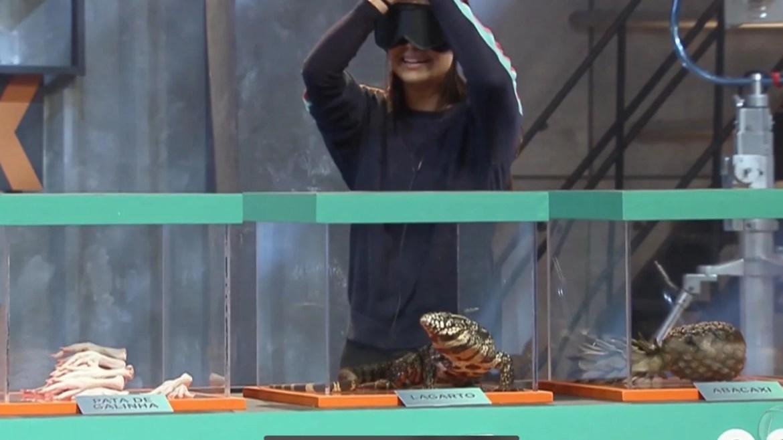 Geórgia entra em desespero ao tocar em um lagarto (imagem: reprodução/ Record TV)