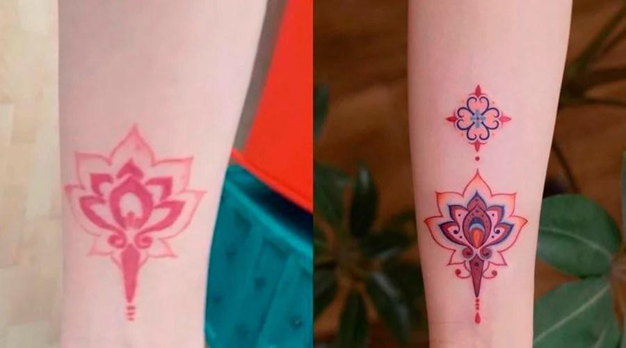 Cobertura de uma tatuagem de um símbolo em vermelho, por uma do mesmo símbolo mas mais colorido e intenso.