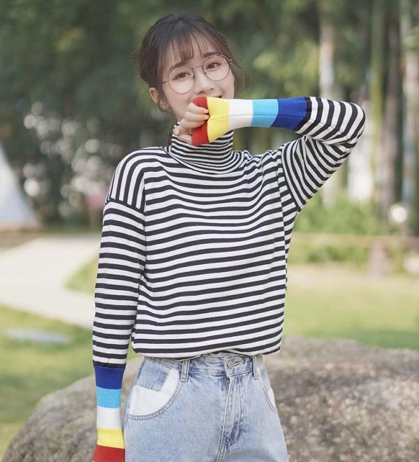 Black And White Striped Sweater With Colorful Sleeves