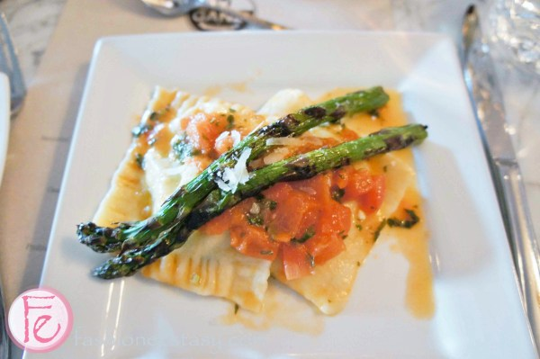 Ravioloni: stuffed with ricotta and spinach, fresh tomato and basil sauce, topped with asparagus