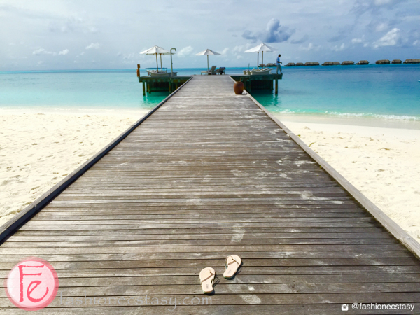 rhea sandals at conrad maldives infinity pool