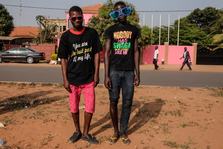 Carnival spectators in Bissau are dressed in funky T-shirts and fun sunglasses. [Ricci Shryock/Al Jazeera]