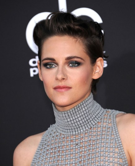 Kristen Stewart with a sleek and slicked back version of a short hairstyle.