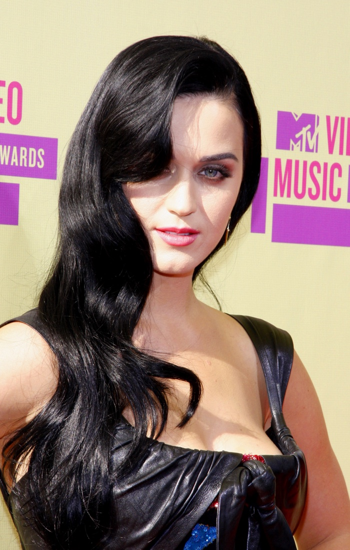 Katy Perry showed off her vampy side at the 2012 MTV Video Music Awards with a long and wavy hairstyle parted to the side. Photo: Tinseltown / Shutterstock.com